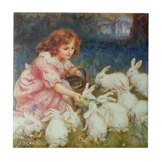 Carreau Rabbites de alimentation de fille
