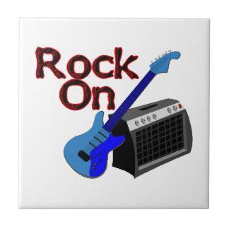 Carreau Roche sur la guitare et l'ampère
