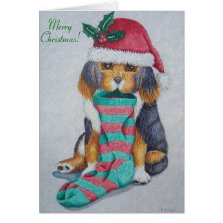 Carte chiot noir et brun mignon avec le bas de Noël