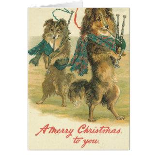 Carte Cornemuse jouant le Joyeux Noël de chiens à vous