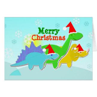 Carte de dinosaures de Joyeux Noël avec le plat de