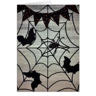 Carte de Halloween d'araignées et de battes