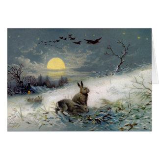 Carte de Noël de bunnys d'hiver
