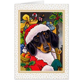 Carte de Noël de teckel de chien de Père Noël