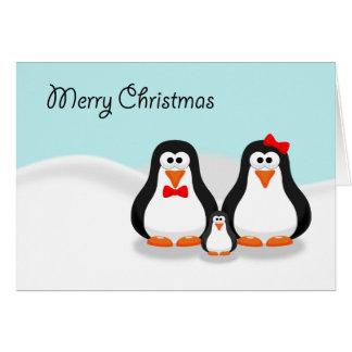 Carte de Noël mignonne de famille de pingouin