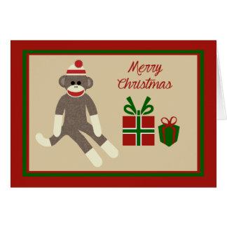 Carte de vacances de Noël de singe de chaussette