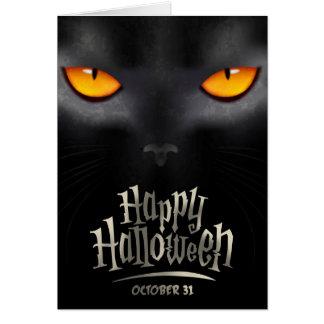 Carte de voeux de Halloween avec le regard félin