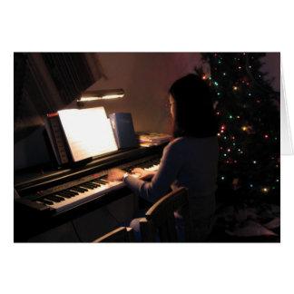 Carte Fille de piano à Noël