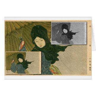 Carte Fille japonaise avec le parapluie sous la pluie