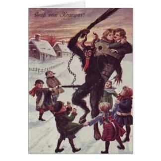 Carte Krampus punissant la neige d'enfants