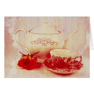 Carte La théière, une tasse de thé et s'est levée
