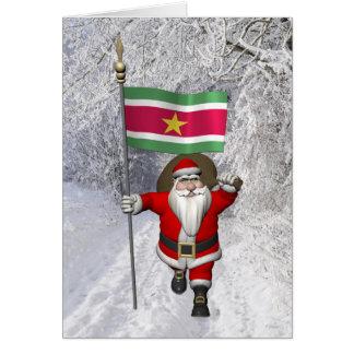 Carte Le père noël avec le drapeau du Surinam