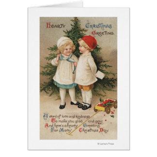 Carte Noël chaleureux GreetingKids par un arbre