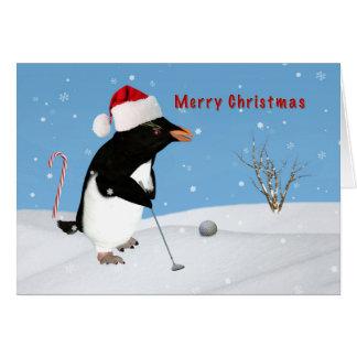 Carte Noël, pingouin jouant au golf
