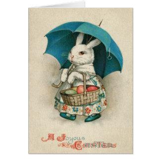Carte Parapluie coloré par panier d'oeufs de lapin de