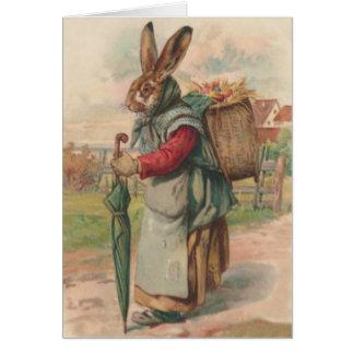 Carte Parapluie peint coloré d'oeufs de lapin de Pâques