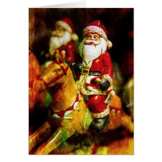 Carte Père Noël monte un carrousel