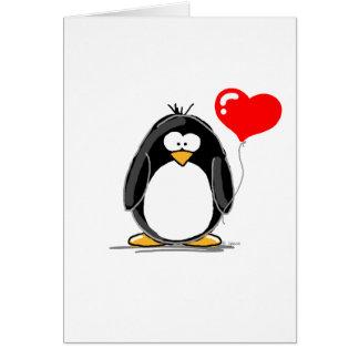 Carte Pingouin avec un ballon de coeur