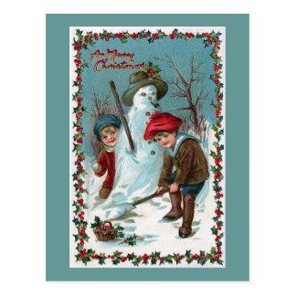 """Carte Postale Cru """"construisant bonhomme de neige"""""""