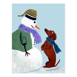 Carte postale de teckel et de bonhomme de neige
