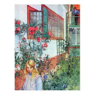 Carte Postale Fille dans le jardin avec les fleurs rouges