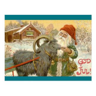 Carte Postale Jultomten alimente à chèvre de Noël un biscuit