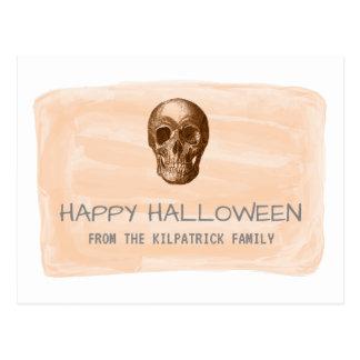 Carte postale orange de Halloween de crâne