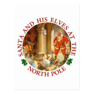 Carte Postale Père Noël dirige des elfes faire des biscuits