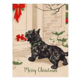 Carte Postale Rétro Terrier livrant le cadeau de Noël