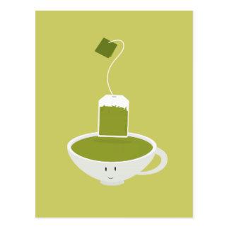 Carte Postale Tasse de sourire de thé vert avec le sachet à thé