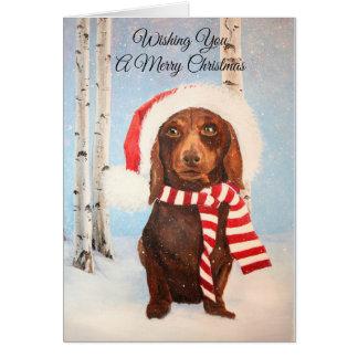 Carte Salutation de Noël de chien de teckel de Père Noël