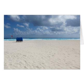 Carte Une chaise de plage attend