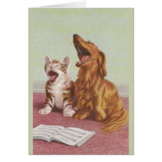Carte vintage de chant de chien et de chat