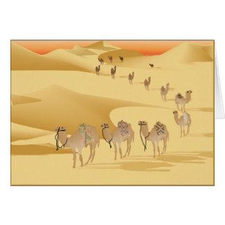 Chameaux de carte de voeux dans le désert