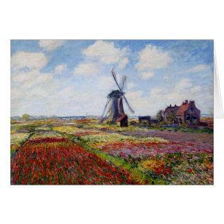 Champ de Monet des tulipes avec la carte de voeux