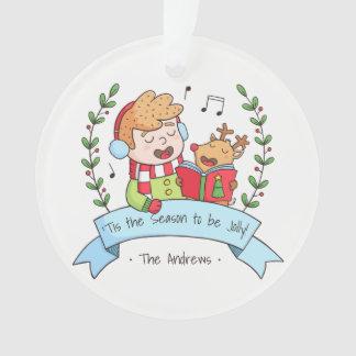Chants de Noël gais garçon et ornement de renne