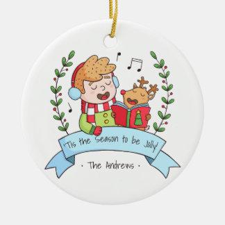 Chants de Noël mignons garçon et ornement de renne