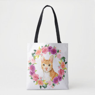 Chat tigré orange avec le sac fourre-tout floral à