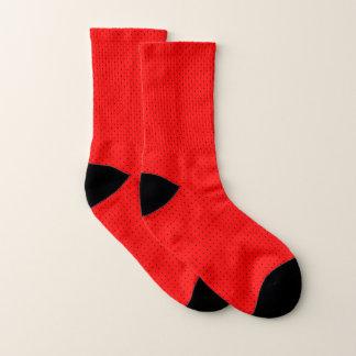 Chaussettes rouges avec les points bleu-foncé