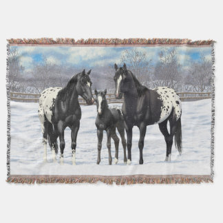 Chevaux noirs d'Appaloosa dans la neige Couvertures