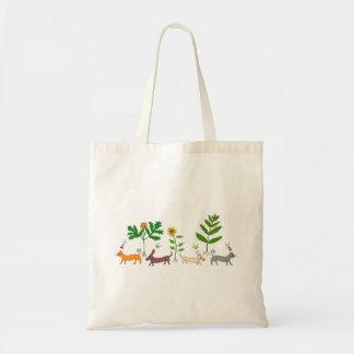 Chiens et chats et sac fourre-tout à plantes