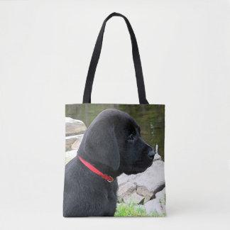 Chiot noir de Labrador - peu de collier rouge Tote Bag