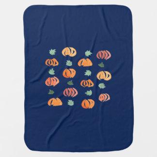 Citrouilles avec la couverture de bébé de feuille