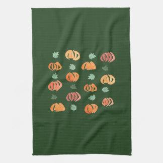 Citrouilles avec la serviette de cuisine de