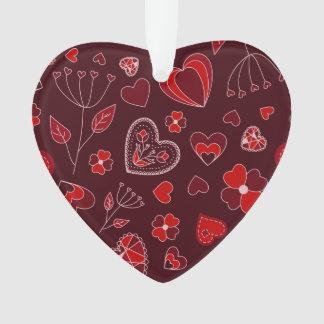 Coeurs et ornement rouges de fleurs