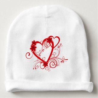 coeurs rouges d'amour de beau vecteur avec l'art bonnet pour bébé