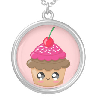 Collier Le petit gâteau avec la cerise et arrose