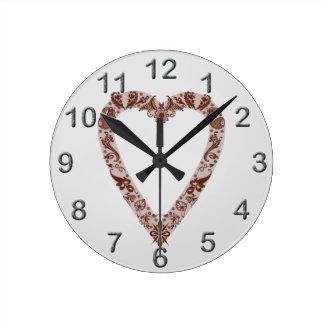 Conception de coeur de henné horloge ronde
