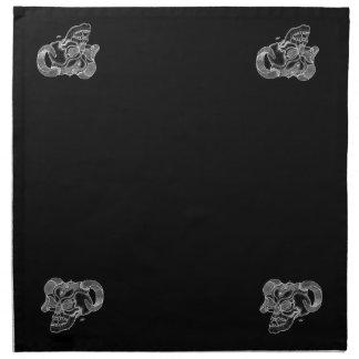 Conception noire et blanche de tête de diable de serviettes de table