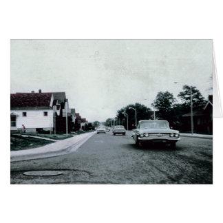 Conduite vintage sur la carte de voeux de route
